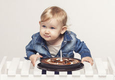 Little baby girl with a cake and a candle Stock Photos