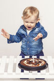 Little baby girl with a cake and a candle Stock Photography