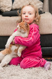 Little baby girl and cat Stock Image