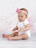 Little baby girl catching bubbles Stock Photography