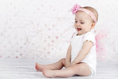 Little baby girl catching bubbles Royalty Free Stock Photography