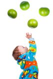 Little baby girl caughts fruits -grapefruit Royalty Free Stock Photos
