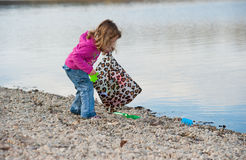 Free Little Baby Girl Cleaning The Beach Royalty Free Stock Image - 17185056