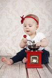 Little baby girl with coffee grinder Stock Images