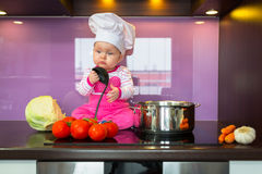 Little baby girl cook  Stock Image