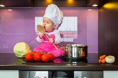 Little baby girl cook Stock Images