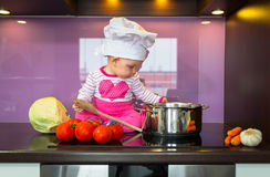 Little baby girl cook Royalty Free Stock Photo