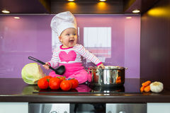 Little baby girl cook Royalty Free Stock Image
