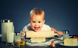 Little baby girl is cooking, baking Royalty Free Stock Images