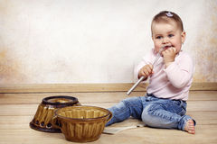Little baby girl cooking Stock Image