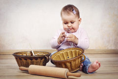 Little baby girl cooking Royalty Free Stock Photo