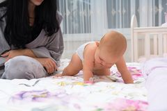 Free Little Baby Girl Crawling Across A Bed. Stock Photo - 131777060