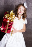 Little baby girl with Cristmas gift Royalty Free Stock Image