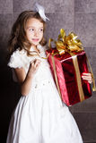 Little baby girl with Cristmas gift Stock Photos