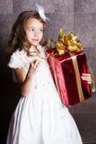Little baby girl with Cristmas gift Stock Photos
