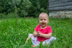 Little baby girl crying bitterly Royalty Free Stock Photo