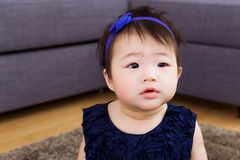 Little baby girl with curiosity expression Royalty Free Stock Photos