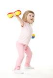 Little baby girl doing sport exercises Stock Photo