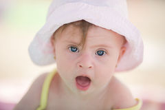 Little baby girl with Downs Syndrome playing in the pool. Cheerful little baby girl with Downs Syndrome playing in the pool Stock Images