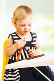 Little baby girl drawing Stock Photography