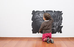 Little baby girl drawing on the wall. Toddler drawing on the wall royalty free stock photos
