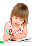 Little baby girl draws pencil Stock Images