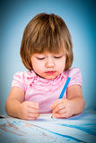 Little baby girl draws pencil Royalty Free Stock Images