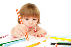 Little baby girl draws pencil Stock Photo