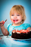 Little baby girl eating cake Royalty Free Stock Images
