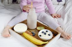 Little baby girl eating healthy breakfast Stock Image