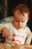 Little baby girl eats pancakes with cheese (children's food, bio Royalty Free Stock Photo