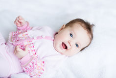 Little baby girl enjoying tummy time in a pink cardigan. Little sweet baby girl enjoying tummy time in a pink cardigan Stock Photography