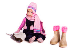 Little baby girl with figure skates Royalty Free Stock Photography