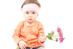 Little baby girl with flowers. Cute little baby girl with flowers for mother on white background Stock Photography