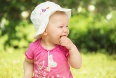 Little baby girl in the garden Stock Image