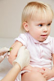 Little baby girl gets an injection Royalty Free Stock Image