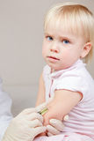Little baby girl gets an injection Royalty Free Stock Photography