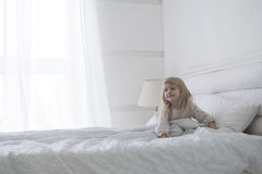 Little baby girl is getting up in the morning with smile Stock Image