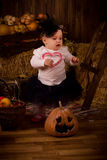 Little baby girl on Halloween party with pumpkin Stock Photo