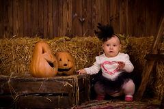 Little baby girl on Halloween party with pumpkin Royalty Free Stock Photography