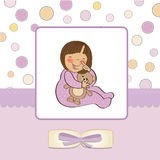 Little baby girl with her teddy Stock Image