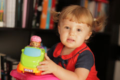 Little baby girl and her toy car Stock Photos