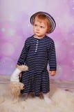 Little baby girl holding teddy bear Stock Photos