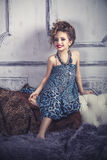 Little baby girl in the image of a glamorous model in a luxurious Royalty Free Stock Photos