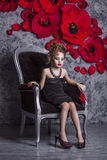 Little baby girl in the image of a glamorous model in a luxurious Stock Image