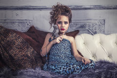 Little baby girl in the image of a glamorous model in a luxurious Stock Images