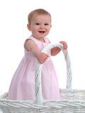 Little Baby Girl In A Big Basket Royalty Free Stock Photography