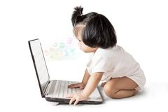 Little baby girl with laptop Royalty Free Stock Photography