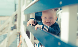 Little baby girl laughing and having fun on a beachhouse stock photo