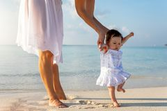 Little baby girl on a tropical beach royalty free stock image